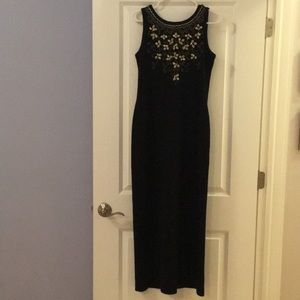 Black knit dress with gold embroidery